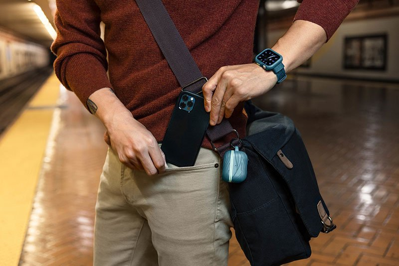 Photo of a person putting a mobile phone in the pocket